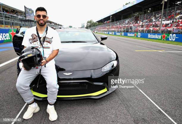 Manchester City and Argentina football player Sergio Aguero prepares to enjoy a Pirelli Hotlap in an Aston Martin driven by Martin Brundle before the...