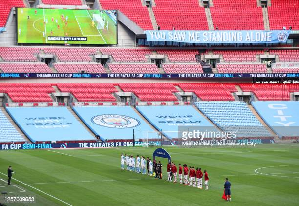 Manchester City and Arsenal players line up during the FA Cup Semi Final match between Arsenal and Manchester City at Wembley Stadium on July 18 2020...