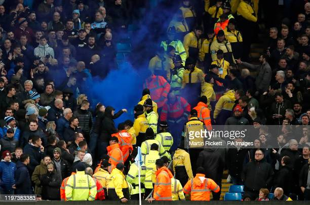 Manchester City and Manchester United fans exchange words during the Carabao Cup Semi Final, second leg match at the Etihad Stadium, Manchester.