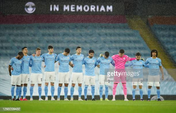 Manchester City and players stand for a minutes silence to remember the lives lost this year associated with football prior to the Premier League...
