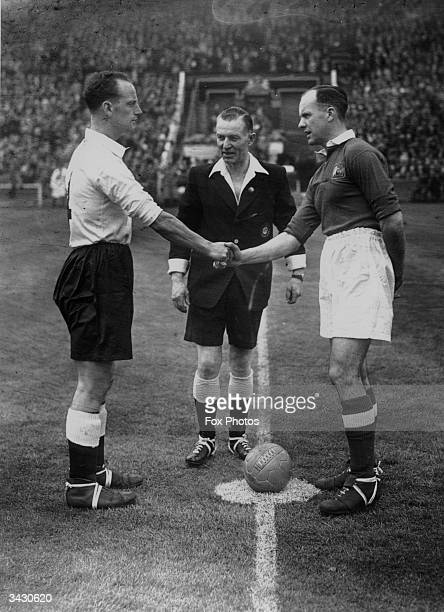 Manchester City captain Sam Cowan and the Portsmouth captain David Thackeray shake hands before the FA Cup final at Wembley 28th April 1934 The...