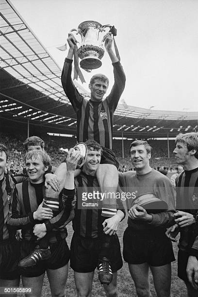 Manchester City captain Tony Book lifts the trophy after his team beat Leicester City 10 to win the FA Cup final at Wembley Stadium London 26th April...