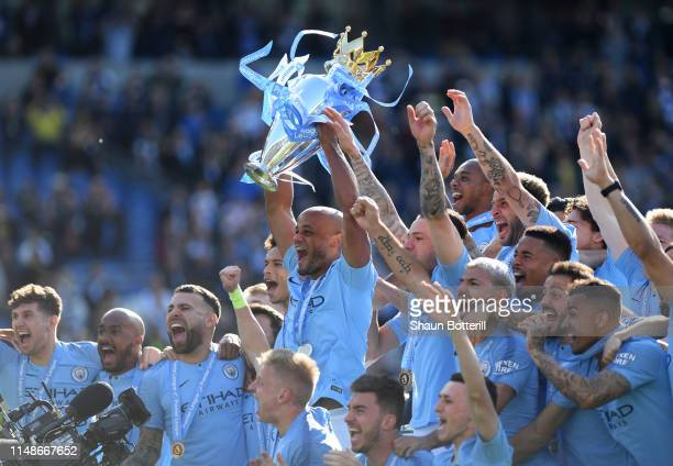 Manchester City captain Vincent Kompany lifts the Premier League Trophy after the Premier League match between Brighton Hove Albion and Manchester...