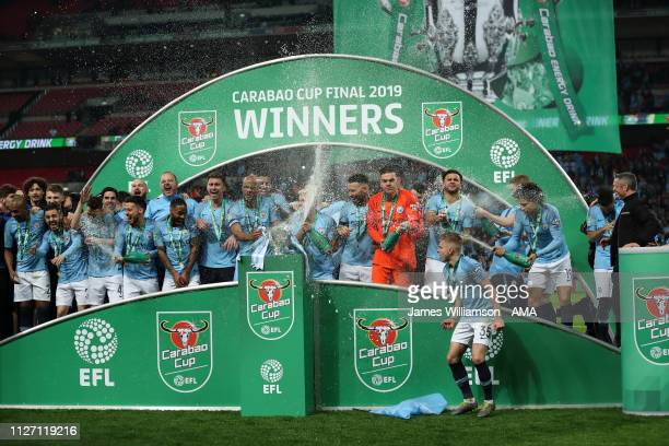 Manchester City celebrate winning the Carabao Cup during the Carabao Cup Final between Chelsea and Manchester City at Wembley Stadium on February 24...