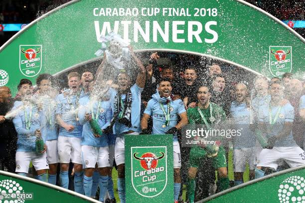 Manchester City celebrate winning the Carabao Cup Final between Arsenal and Manchester City at Wembley Stadium on February 25 2018 in London England