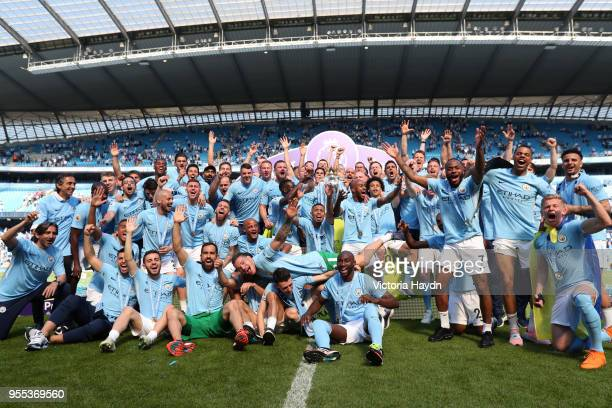 Manchester City celebrates with The Premier League Trophy after the Premier League match between Manchester City and Huddersfield Town at Etihad...