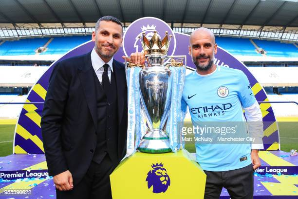 Manchester City chairman Khaldoon Al Mubarak poses with manager Pep Guardiola and the Premier League trophy after the Premier League match between...