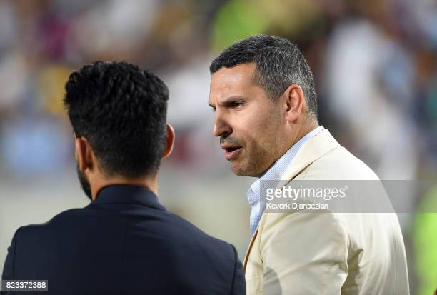 Manchester City Chairman Khaldoon Al Mubarak speaks with Ilkay Gundogan during the International Champions Cup 2017 soccer match against Real Madrid...