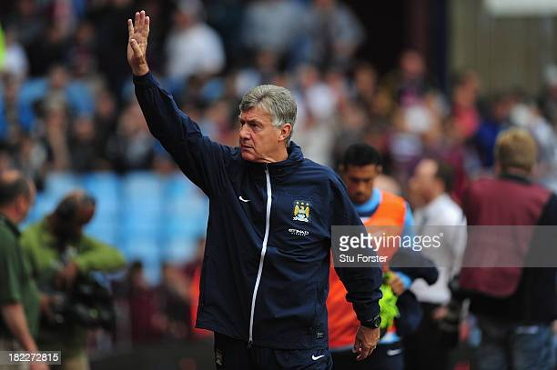 Manchester City coach Brian Kidd waves before the Barclays Premier League match between Aston Villa and Manchester City at Villa Park on September 28...