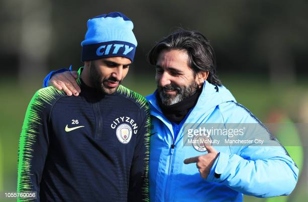 Manchester City coach Lorenzo Buenaventura speaks with Riyad Mahrez during the training session at Manchester City Football Academy on October 31...