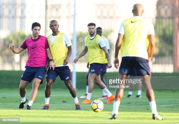 Manchester City coach Mikel Arteta trains with Fernandinho and teammates during the training session on March 16 2018 in Abu Dhabi United Arab...
