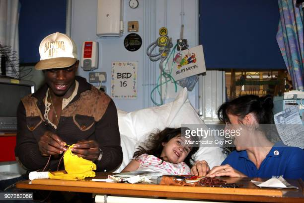 Manchester City Community Day Manchester Royal Children's Hospital Manchester City's Micah Richards helps Laura Mulligan with her sewing while...