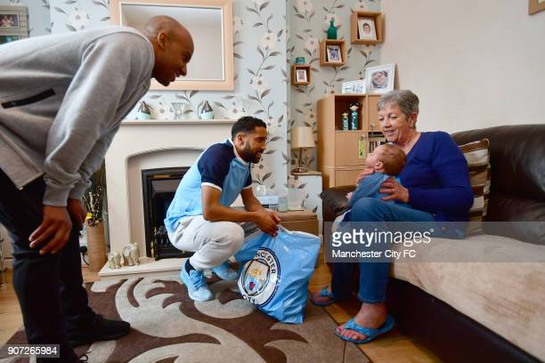 Manchester City Community Visit Manchester City players Fabian Delph and Gael Clichy visit 6weekold Zak Woolfenden and father Matthew in the Abbey...