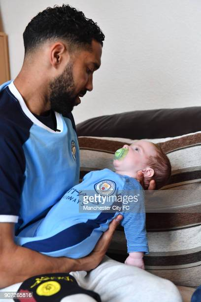 Manchester City Community Visit Manchester City players Gael Clichy visits 6weekold Zak Woolfenden and father Matthew in the Abbey Hey area of...