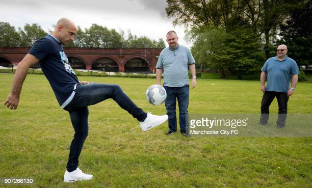 Manchester City Community Visit Pablo Zabaleta in action has a kick about with fans in the park