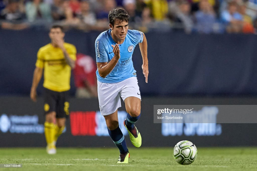 https://media.gettyimages.com/photos/manchester-city-defender-eric-garcia-chases-the-ball-during-an-cup-picture-id1004143348