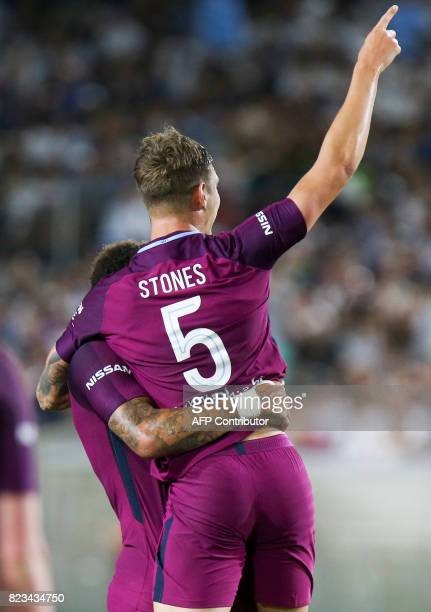 Manchester City defender John Stones celebrates his goal during the second half of the International Champions Cup match against Real Madrid on July...