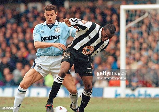 Manchester City defender Keith Curle challenges Newcastle United striker Faustino Asprilla during the FA Premier League match at Maine Road in...