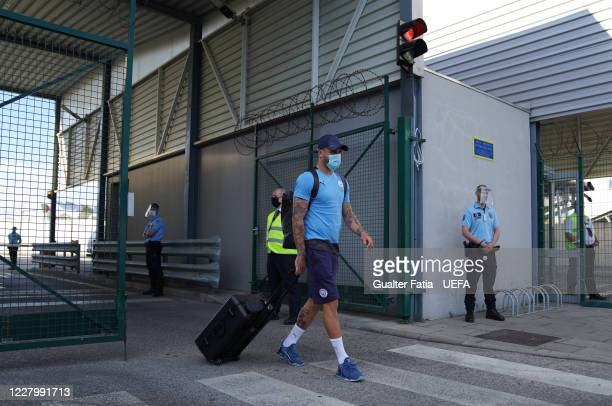 Manchester City defender Kyle Walker arrives with Manchester City team in Lisbon for the Champions League at Humberto Delgado Airport on August 10,...