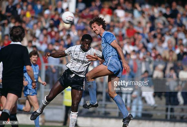 Manchester City defender Mick McCarthy outjumps Notts County's Justin Fashanu during their 2nd Division match at Meadow Lane May 6th 1985 Notts...