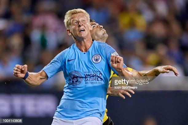 Manchester City defender Oleksandr Zinchenko battles with Borussia Dortmund midfielder Christian Pulisic during an International Champions Cup match...