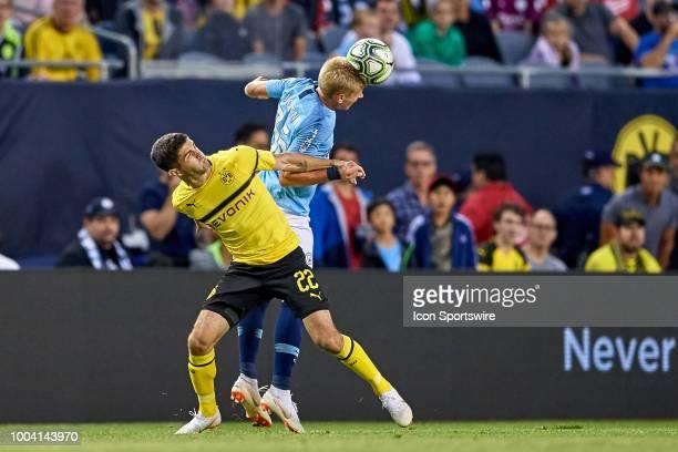 Manchester City defender Oleksandr Zinchenko battles with Borussia Dortmund midfielder Christian Pulisic to head the ball during an International...