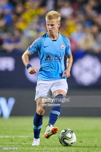 Manchester City defender Oleksandr Zinchenko controls the ball during an International Champions Cup match between Manchester City and Borussia...