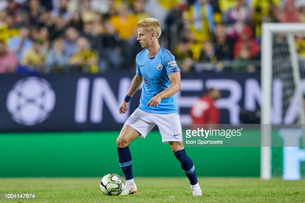 Manchester City defender Oleksandr Zinchenko dribbles the ball during an International Champions Cup match between Manchester City and Borussia...