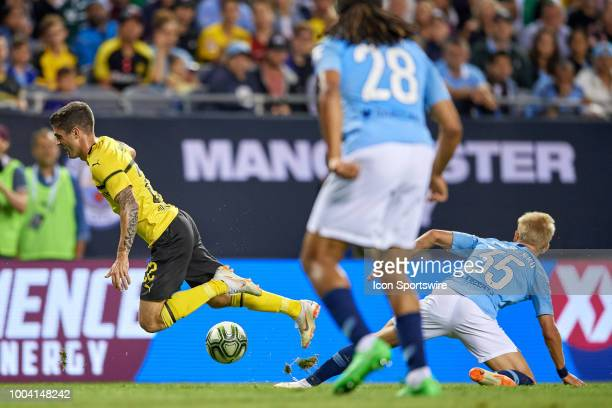 Manchester City defender Oleksandr Zinchenko fouls Borussia Dortmund midfielder Christian Pulisic in the box causing a penalty kick in the first half...