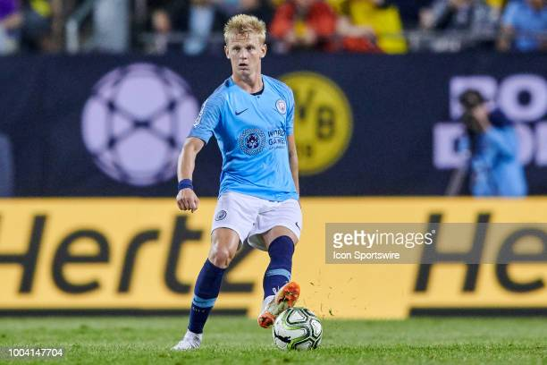 Manchester City defender Oleksandr Zinchenko handles the ball during an International Champions Cup match between Manchester City and Borussia...