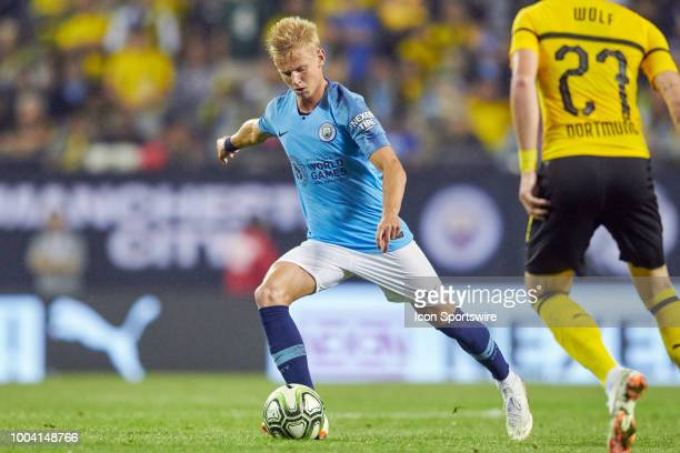 Manchester City defender Oleksandr Zinchenko shoots the ball during an International Champions Cup match between Manchester City and Borussia...