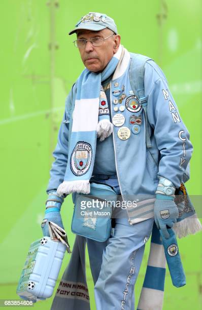 Manchester City fan arrives at the stadium prior to the Premier League match between Manchester City and West Bromwich Albion at Etihad Stadium on...