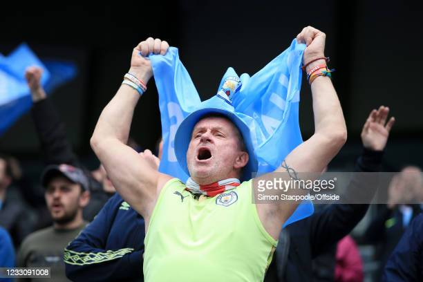 Manchester City fan cheers on his side during the Premier League match between Manchester City and Everton at Etihad Stadium on May 23, 2021 in...