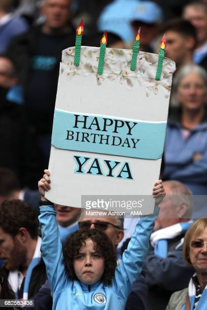 Manchester City fan displays a birthday message for Yaya Toure during the Premier League match between Manchester City and Leicester City at Etihad...