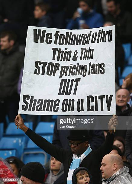 Manchester City fan displays a message relating to ticket prices during the Barclays Premier League match between Manchester City and West Bromwich...