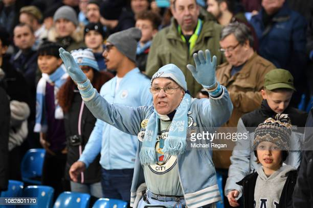 Manchester City fan enjoy the pre match atmosphere prior to the Premier League match between Manchester City and Wolverhampton Wanderers at Etihad...