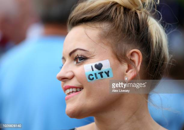Manchester City fan enjoys the pre match atmosphere prior to the Premier League match between Manchester City and Newcastle United at Etihad Stadium...