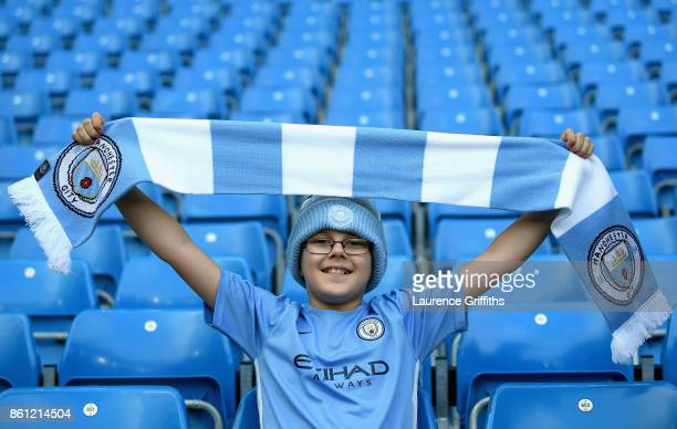 Manchester City fan enjoys the pre match atmosphere prior to the Premier League match between Manchester City and Stoke City at Etihad Stadium on...