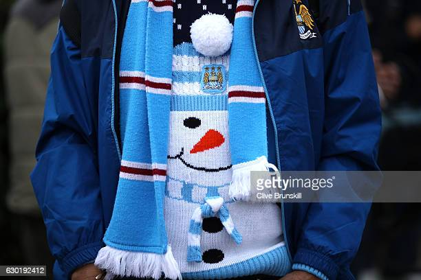 Manchester City fan gets in the festive mood with a christmas jumper prior to the Premier League match between Manchester City and Arsenal at the...