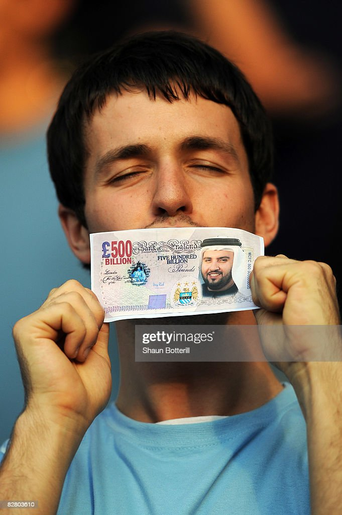 Manchester City fan holds a fake British Pound note with the face of Dr Sulaiman Al Fahim during the Barclays Premier League match between Manchester City and Chelsea at The City of Manchester Stadium on September 13, 2008 in Manchester, England.