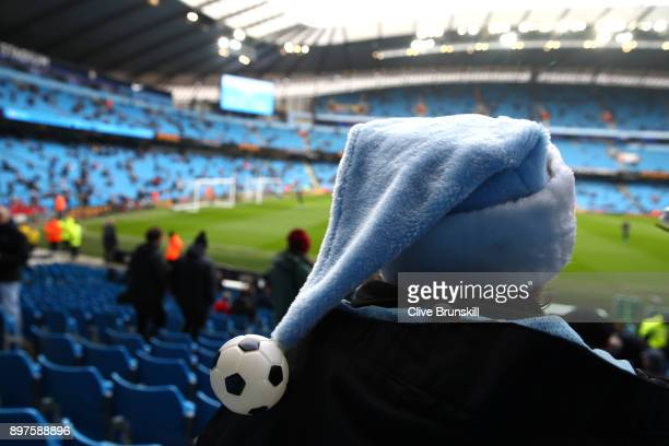 Manchester City fan looks on inside the stadium prior to the Premier League match between Manchester City and AFC Bournemouth at Etihad Stadium on...