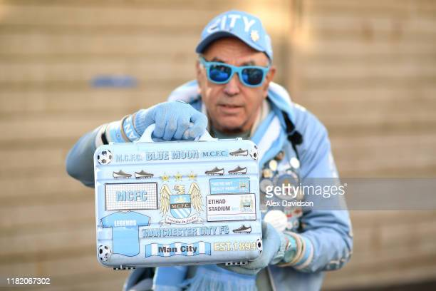 Manchester City fan poses for a photograph outside the stadium prior to the Premier League match between Crystal Palace and Manchester City at...