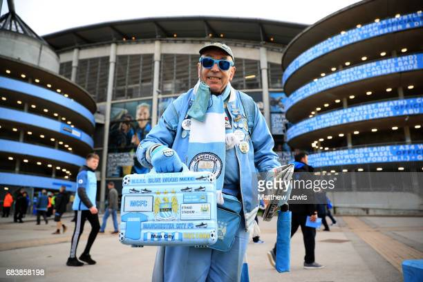 Manchester City fan poses outside the stadium prior to the Premier League match between Manchester City and West Bromwich Albion at Etihad Stadium on...