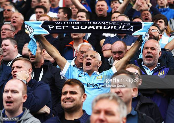 Manchester City fan shows his surport for the manager during the Premier League match between Stoke City and Manchester City at Bet365 Stadium on...