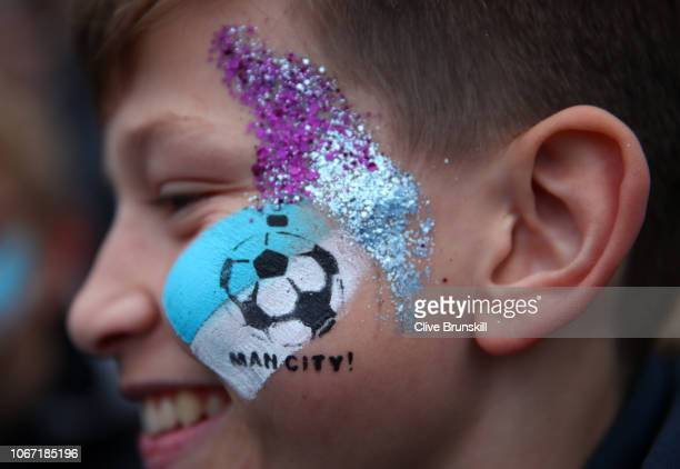 Manchester City fan shows off their face paint prior to the Premier League match between Manchester City and AFC Bournemouth at Etihad Stadium on...