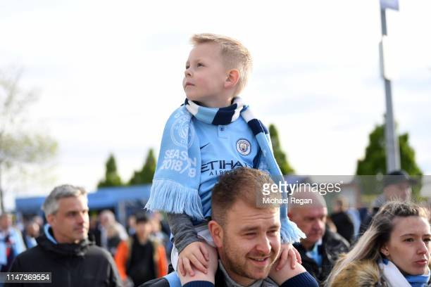 Manchester City fan waits for the team to arrive prior to the Premier League match between Manchester City and Leicester City at Etihad Stadium on...
