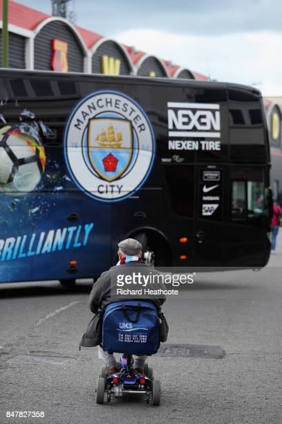 Manchester City fan watches the Manchester City team bus arrive at the stadium prior to the Premier League match between Watford and Manchester City...