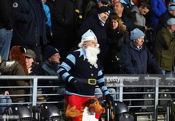 Manchester City fan wears festive fancy dress during the Premier League match between Hull City and Manchester City at KCOM Stadium on December 26...