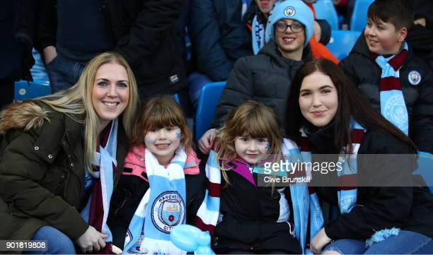 Manchester City fans ahead of the The Emirates FA Cup Third Round match between Manchester City and Burnley at Etihad Stadium on January 6 2018 in...