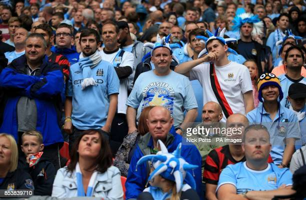 Manchester City fans appear dejected in the stands during the Community Shield match at Wembley Stadium London